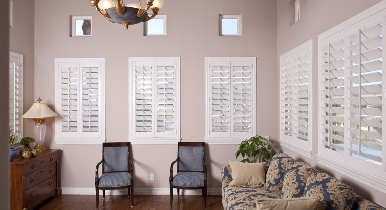Chic parlor with casement shutters