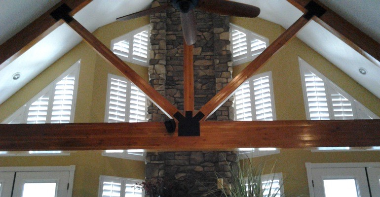 rake windows with custom shutters in Destin house