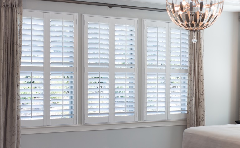 Destin plantation shutters bedroom