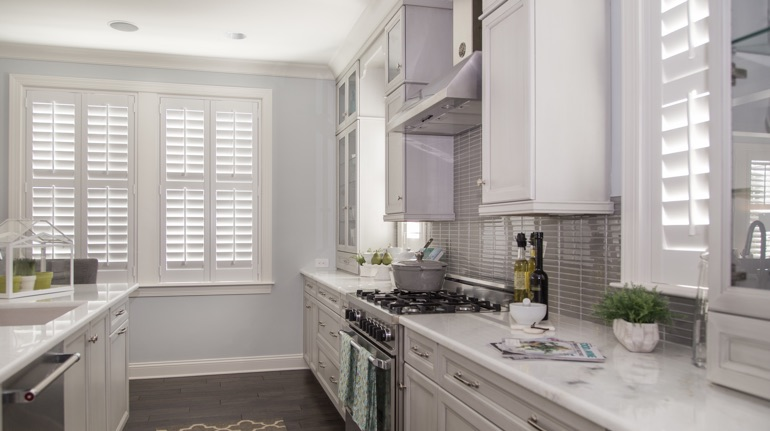 Polywood shutters in Destin kitchen with white cabinets.