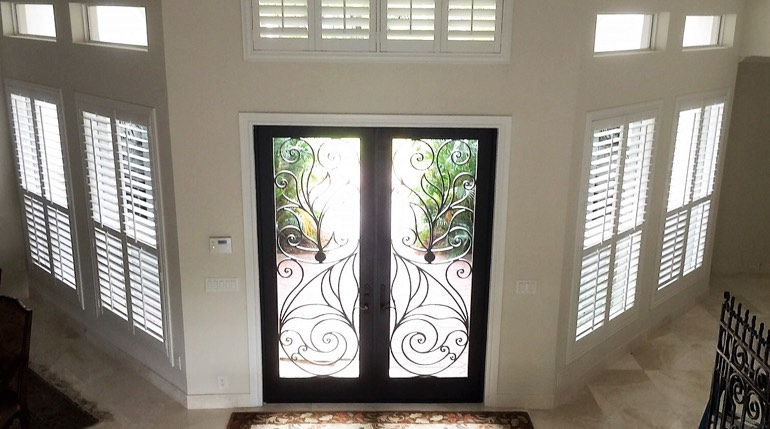 Destin foyer with glass doors and plantation shutters