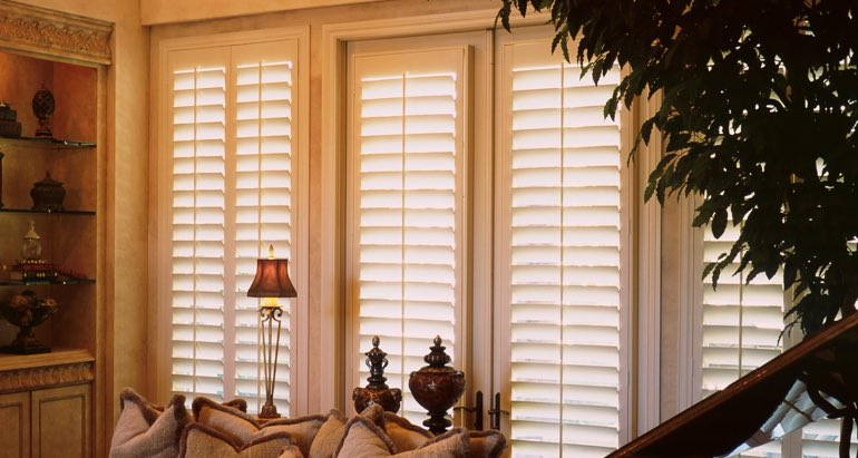 Plantation shutters on windows and door in Destin parlor