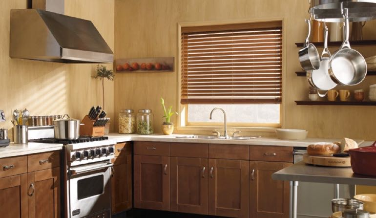 Destin kitchen faux wood blinds.