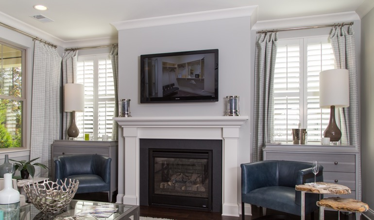 Destin fireplace with plantation shutters.
