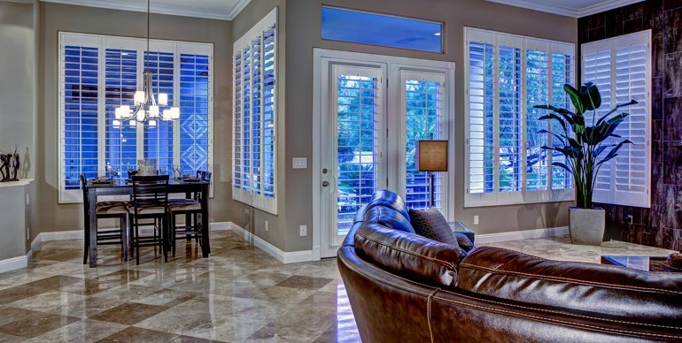 Destin great room with plantation shutters and modern lighting.