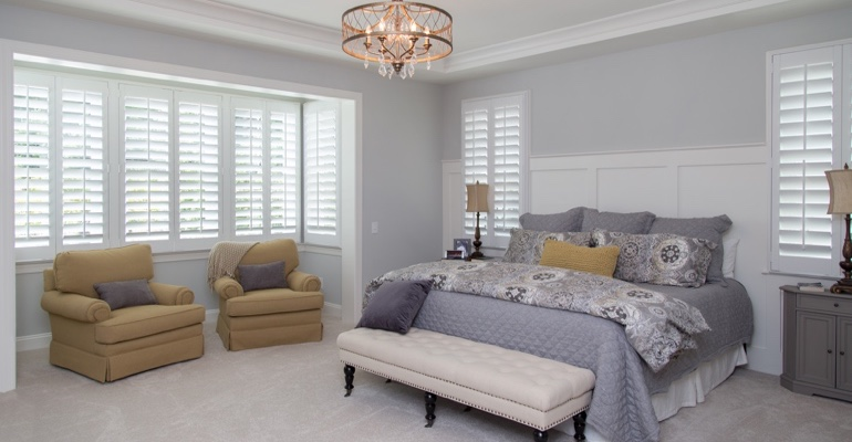 Interior shutters in Destin bedroom.
