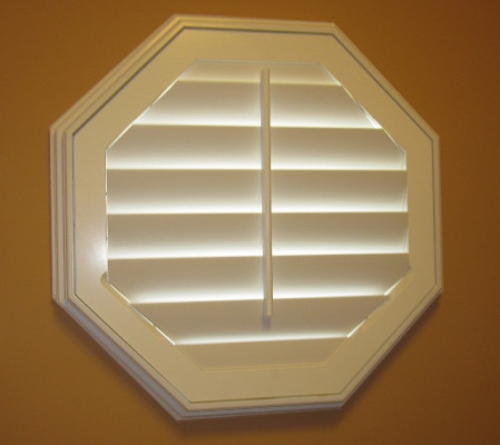 Destin octagon window with white shutter