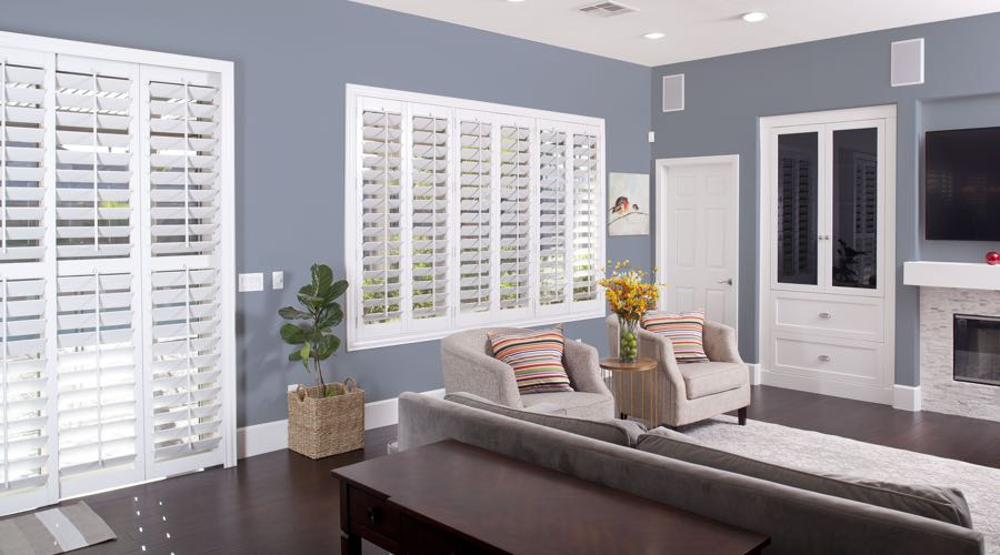 Faux Wood Shutters In pretty Destin Living Room