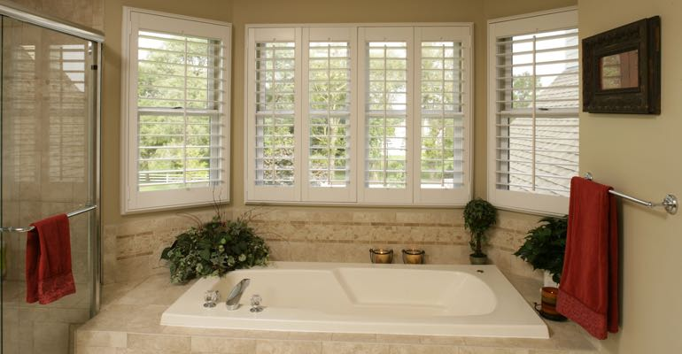 Plantation shutters in Destin bathroom.