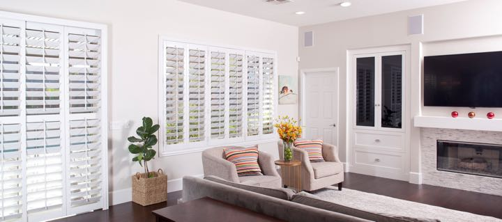 Destin living room in white with plantation shutters.