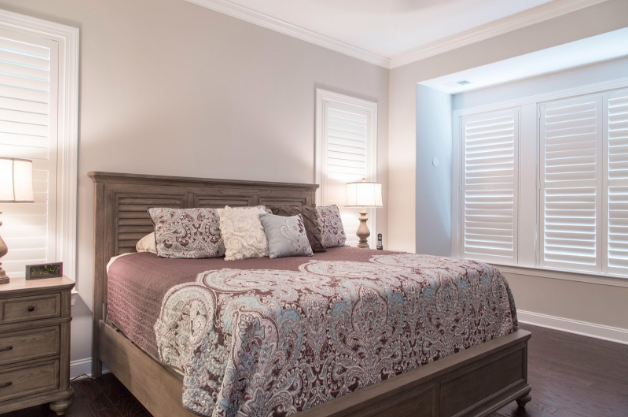 Destin bedroom with light block shutters
