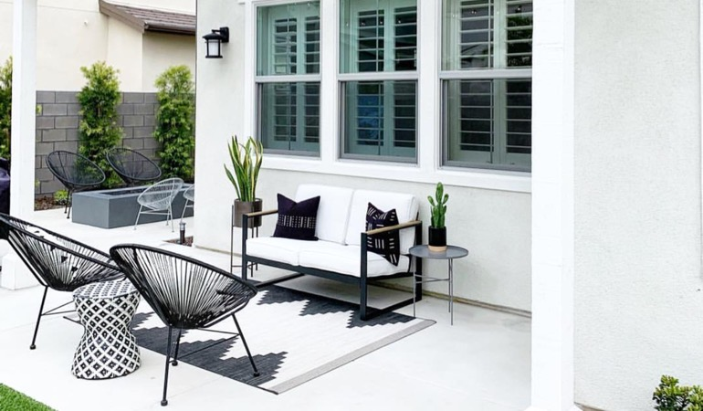 An outside patio with plantation shutters