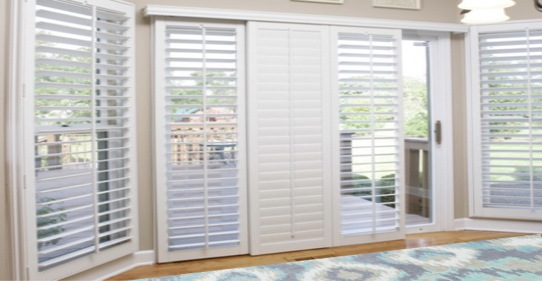 [Polywood|Plantation|Interior ]211] shutters on a sliding glass door in Destin