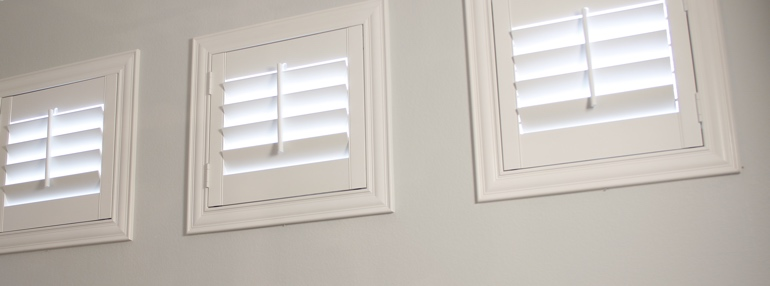 Small Windows in a Destin Garage with Polywood Shutters