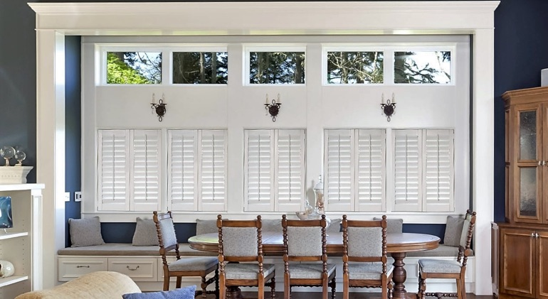Closed studio plantation shutters in Destin dining room.