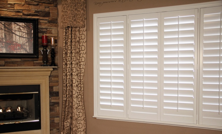 Destin Studio plantation shutters in family room.