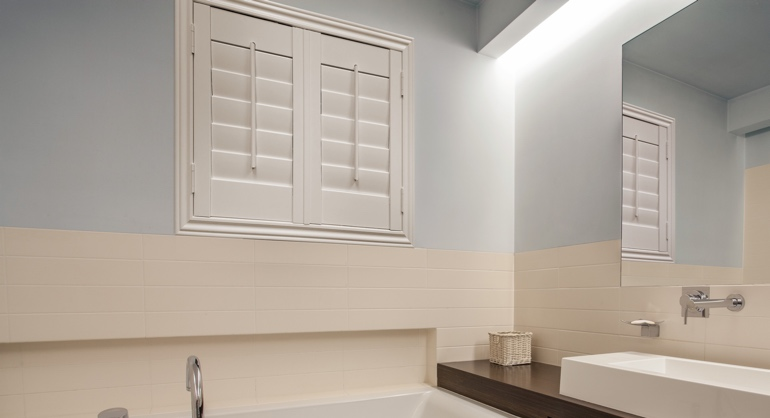 Studio waterproof shutters in Destin bathroom.