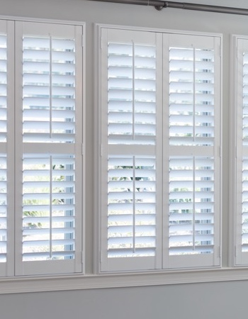 Hidden tilt rod shutters on Destin windows