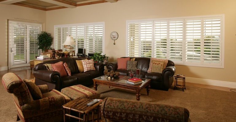 Destin sunroom with white shutters.