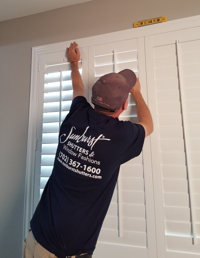 Shutter installation in Destin bedroom.