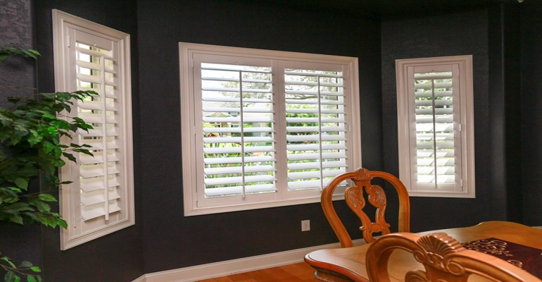 Crisp Plantation Shutters In Dining Room With Dark Paint