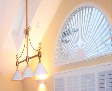 Destin arched eyebrow window with white shutter