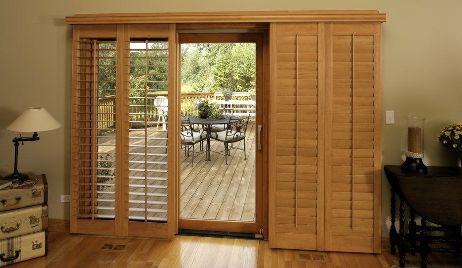 Bypass wood patio door shutters in Destin living room