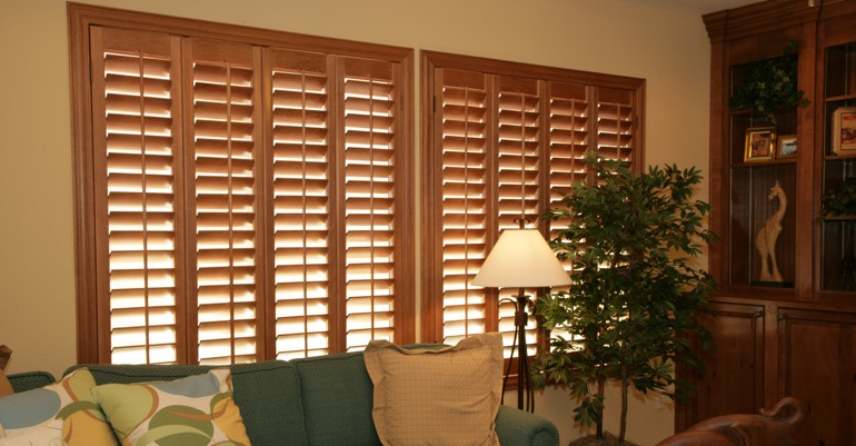 Natural wood shutters in Destin living room.