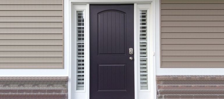 Sidelight Shutters On Black Door In Destin, Florida