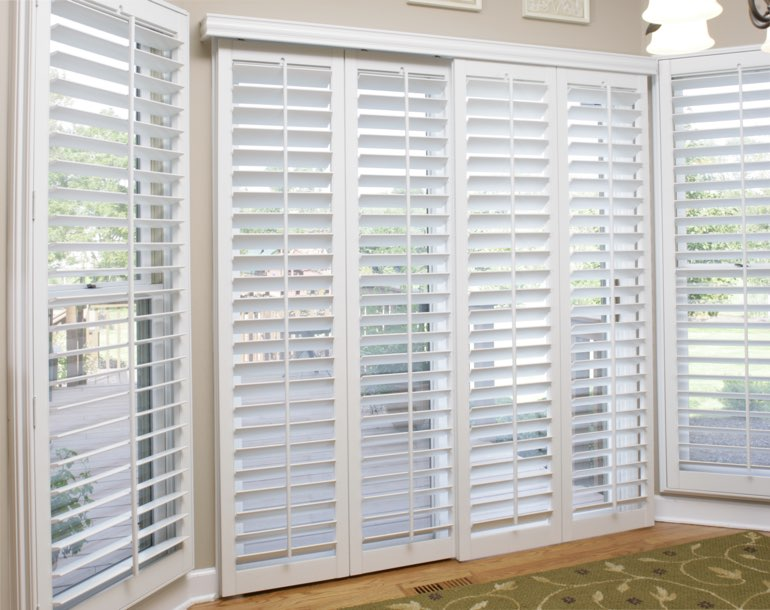 Sliding glass door with plantation shutters Destin
