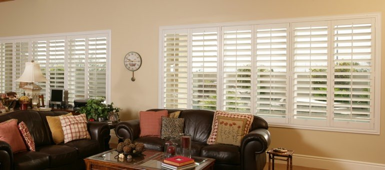 Wide window with plantation shutters in Destin living room